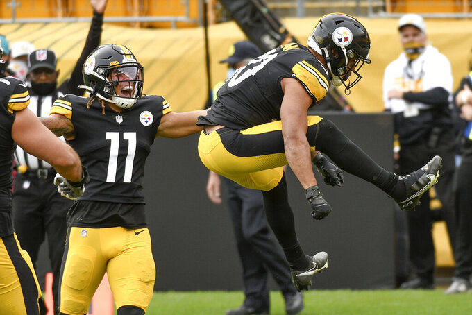Pittsburgh Steelers running back James Conner (30) leaps after scoring a touchdown against the Cleveland Browns during the first half of an NFL football game, Sunday, Oct. 18, 2020, in Pittsburgh. Steelers wide receiver Chase Claypool (11) also reacts. (AP Photo/Don Wright)
