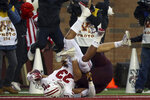 Wisconsin running back Jonathan Taylor (23) falls in the end zone for touchdown against Minnesota linebacker Carter Coughlin (45) during an NCAA college football game Saturday, Nov. 30, 2019, in Minneapolis. (AP Photo/Stacy Bengs)