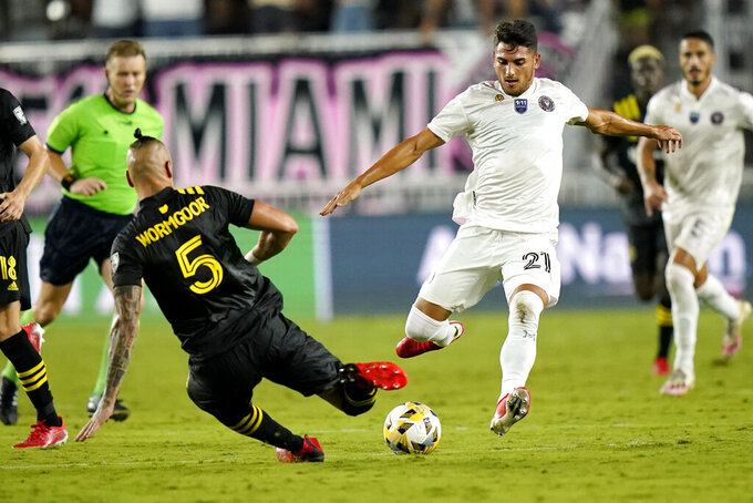Inter Miami forward Julian Carranza (21) prepares to kick the ball as Columbus Crew defender Vito Wormgoor (5) defends during the second half of an MLS soccer match Saturday, Sept. 11, 2021, in Fort Lauderdale, Fla. Inter Miami won 1-0. (AP Photo/Lynne Sladky)