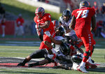 Hawaii linebacker Darius Muasau (53) and defensive lineman Jonah Laulu (99) tackle New Mexico running back Daevon Vigilant (5) during the second half of an NCAA college football game on Saturday, Oct. 26, 2019, in Albuquerque, N.M. (AP Photo/Andres Leighton)