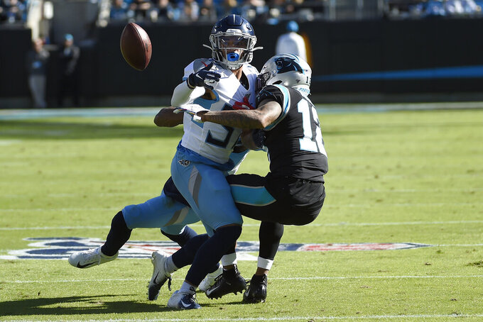 Tennessee Titans defensive back Amani Hooker (37) breaks up a pass intended for Carolina Panthers wide receiver D.J. Moore (12) during the first half of an NFL football game in Charlotte, N.C., Sunday, Nov. 3, 2019. (AP Photo/Mike McCarn)