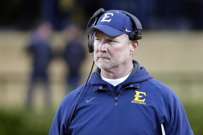 ETSU head coach Randy Sanders watches from the sideline in the first half of an NCAA college football game against the Vanderbilt Saturday, Nov. 23, 2019, in Nashville, Tenn. (AP Photo/Mark Humphrey)