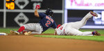 Boston Red Sox's Xander Bogaerts (2) is tagged out on a steal at second base by Philadelphia Phillies shortstop Jean Segura (2) during the fourth inning of a baseball game Saturday, Sept. 14, 2019, in Philadelphia. (AP Photo/Laurence Kesterson)