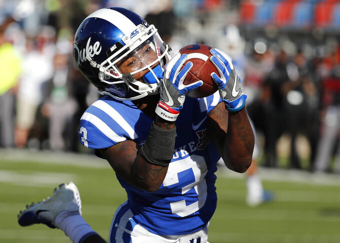 Duke wide receiver T.J. Rahming (3) hauls in a touchdown pass reception against Temple during the first half of the Independence Bowl, an NCAA college football game in Shreveport, La., Thursday, Dec. 27, 2018. (AP Photo/Rogelio V. Solis)