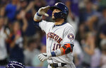 Houston Astros' Yuli Gurriel crosses home plate after hitting a two-run home run off Colorado Rockies relief pitcher Jake McGee in the seventh inning of a baseball game Tuesday, July 2, 2019, in Denver. (AP Photo/David Zalubowski)