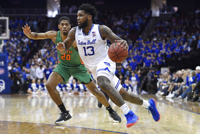 Seton Hall guard Myles Powell (13) drives past Florida A&M guard Brendon Myles (20) defends during the second half of an NCAA college basketball game, Saturday, Nov. 23, 2019 in Newark, N.J. (AP Photo/Sarah Stier)