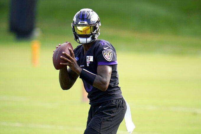 Baltimore Ravens quarterback Lamar Jackson works out during an NFL football training camp practice, Monday, Aug. 24, 2020, in Owings Mills, Md. (AP Photo/Julio Cortez)