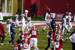 Penn State players leave the field as Indiana players celebrate following an NCAA college football game, Saturday, Oct. 24, 2020, in Bloomington, Ind. Indiana won 36-35 in overtime. (AP Photo/Darron Cummings)