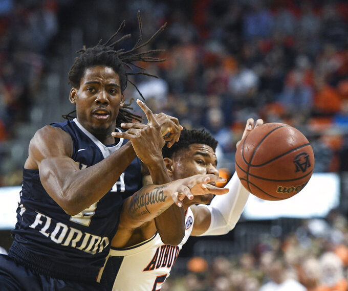 North Florida forward Wajid Aminu (2) and Auburn forward Chuma Okeke (5) reach for the ball during the first half of an NCAA college basketball game Saturday, Dec. 29, 2018, in Auburn, Ala. (AP Photo/Julie Bennett)