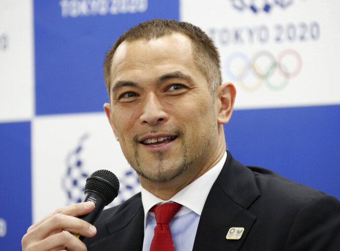 Tokyo 2020 Sports Director Koji Murofushi speaks during a press conference to unveil detailed Olympic competition schedule in Tokyo, Tuesday, April 16, 2019. For fans, athletes, and volunteers in Japan, next year's Olympics in Tokyo could become known as the get-up-early games.Organizers announced Tuesday that - hoping to beat summer heat in the Japanese capital - the men's 50-meter race walk final will begin at 5:30 a.m. The men's and women's marathon final will start at 6 a.m. (AP Photo/Koji Sasahara)