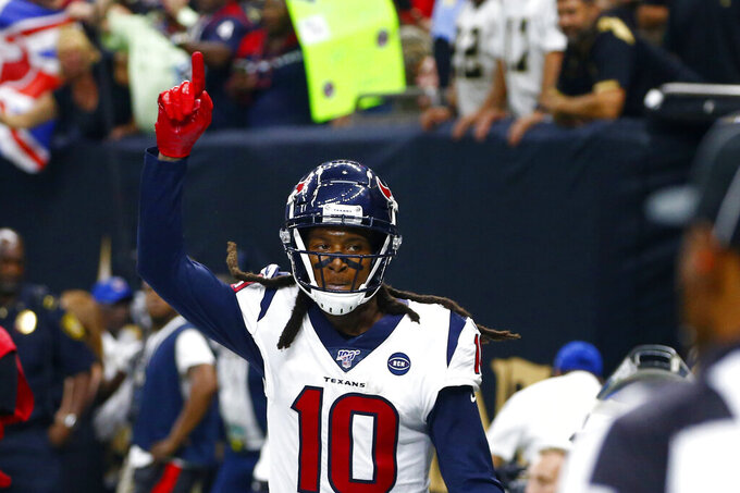 Houston Texans wide receiver DeAndre Hopkins (10) celebrates his touchdown in the first half of an NFL football game against the New Orleans Saints in New Orleans, Monday, Sept. 9, 2019. (AP Photo/Butch Dill)