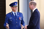 Britain's Prince William, right, meets New Zealand's Commissioner of police Mike Bush during a visit to the Justice and Emergency Services Precinct in Christchurch, New Zealand, Thursday, April 25, 2019. Prince William is on a two-day visit to New Zealand to take part in ANZAC ceremonies and visit the two mosques where a gunman killed 50 people on March 15. (Marty Melville/Pool Photo via AP)