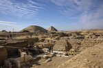 CORRECTS DAY OF WEEK TO SUNDAY -- The excavation site where Egyptian archaeologist Zahi Hawass and his team unearthed a trove of ancient coffins, artifacts, and skulls in a vast necropolis south of Cairo, Sunday, Jan. 17, 2021, in Saqqara, south of Cairo, Egypt. (AP Photo/Nariman El-Mofty)