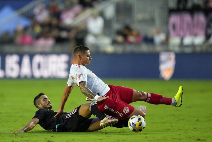 New York Red Bulls forward Patryk Klimala, top, is brought down Inter Miami defender Nicolas Figal, bottom, during the first half of an MLS soccer match Friday, Sept. 17, 2021, in Fort Lauderdale, Fla. (AP Photo/Rebecca Blackwell)