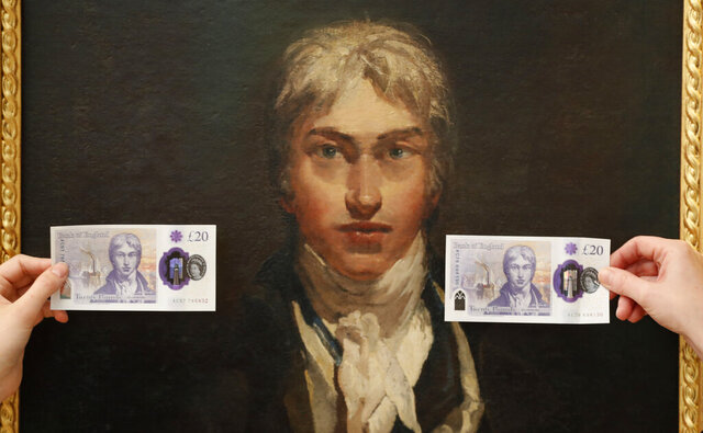 New 20 pound notes are displayed in front of a self portrait of JMW Turner during a photo opportunity at the Tate Britain in London, Thursday, Feb. 20, 2020. The new 20 pound note featuring the artist JMW Turner enters circulation on Feb. 20. (AP Photo/Frank Augstein)