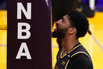 Los Angeles Lakers forward Anthony Davis touches his face to a pad on part of the basket during the second half of an NBA basketball game against the Denver Nuggets Monday, May 3, 2021, in Los Angeles. (AP Photo/Mark J. Terrill)