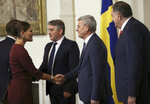 Members of the tripartite Presidency of Bosnia and Herzegovina: Croat member Zeljko Komsic, third right, Muslim member Sefik Dzaferovic, second right, and Bosnian Serb member Milorad Dodik, right, welcome Sweden's Crown Princess Victoria prior to their meeting, in Sarajevo, Bosnia-Herzegovina, Wednesday, Nov. 6, 2019. Swedish Crown Princess Victoria has urged Bosnian leaders to commit to tackling the climate change and environmental pollution, saying it was one of the key challenges they will have to address if they want to bring their country into the European Union. (AP Photo/Kemal Softic)
