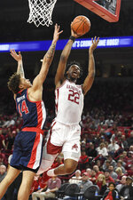 Arkansas forward Gabe Osabuohien (22) drives to the hoop against Mississippi defender KJ Buffen (14) during the first half of an NCAA college basketball game, Saturday, March 2, 2019 in Fayetteville, Ark. (AP Photo/Michael Woods)