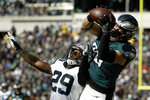 FILE - In this Oct. 21, 2018, file photo, Philadelphia Eagles tight end Zach Ertz, right, makes a catch against Carolina Panthers free safety Mike Adams during the first half of an NFL football game in Philadelphia. Eagles star Zach Ertz made 116 receptions, a new mark for by a tight end. (AP Photo/Matt Rourke, File)