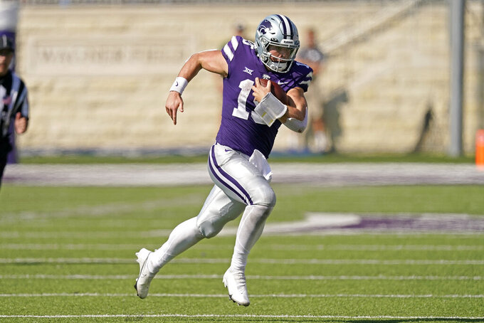 Kansas State quarterback Will Howard runs for a first down during the second half of an NCAA college football game against Nevada Saturday, Sept. 18, 2021, in Manhattan, Kan. (AP Photo/Charlie Riedel)
