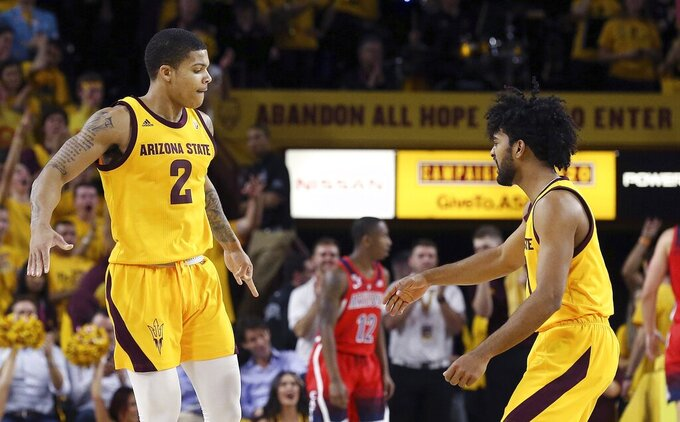 Arizona State guard Rob Edwards (2) celebrates a three-point basket against Arizona with teammate Remy Martin, right, during the first half of an NCAA college basketball game Thursday, Jan. 31, 2019, in Tempe, Ariz. (AP Photo/Ross D. Franklin)