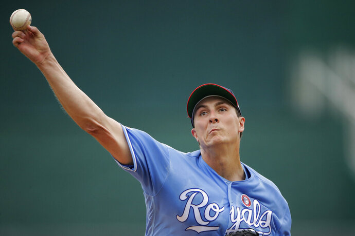 Kansas City Royals starting pitcher Homer Bailey throws during the first inning of a baseball game against the Cleveland Indians Thursday, July 4, 2019, in Kansas City, Mo. (AP Photo/Charlie Riedel)