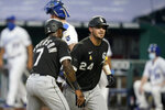 Chicago White Sox's Yasmani Grandal (24) is congratulated by teammate Tim Anderson (7) after his two-run home run during the fifth inning of a baseball game against the Kansas City Royals at Kauffman Stadium in Kansas City, Mo., Saturday, Sept. 5, 2020. (AP Photo/Orlin Wagner)