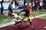 Boston College wide receiver CJ Lewis (11) makes a touchdown reception against Louisville cornerback Kei'Trel Clark during the second half of an NCAA college football game, Saturday, Nov. 28, 2020, in Boston. (AP Photo/Michael Dwyer)