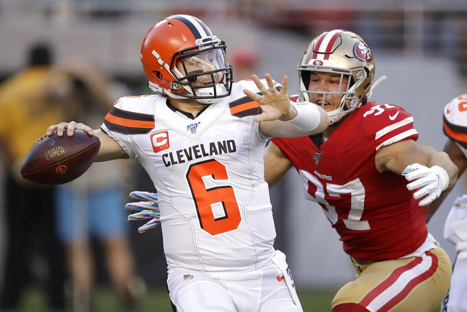 Cleveland Browns quarterback Baker Mayfield (6) passes as San Francisco 49ers defensive end Nick Bosa applies pressure during the first half of an NFL football game in Santa Clara, Calif., Monday, Oct. 7, 2019. (AP Photo/Ben Margot)