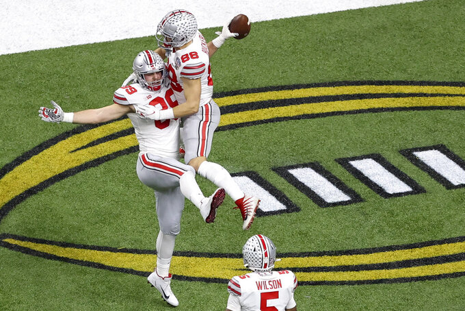 Ohio State tight end Luke Farrell celebrates after scoring with tight end Jeremy Ruckert during the first half of the Sugar Bowl NCAA college football game against Clemson Friday, Jan. 1, 2021, in New Orleans. (AP Photo/Butch Dill)