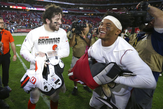 Arizona Cardinals quarterback Kyler Murray, right, greets Cleveland Browns quarterback Baker Mayfield after an NFL football game, Sunday, Dec. 15, 2019, in Glendale, Ariz. The Cardinals won 38-24. (AP Photo/Ross D. Franklin)