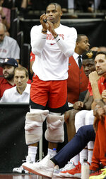Houston Rockets guard Russell Westbrook watches from the bench area during the first half of the team's NBA basketball game against the Milwaukee Bucks, Thursday, Oct. 24, 2019, in Houston. (AP Photo/Eric Christian Smith)