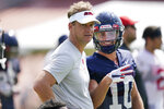 Mississippi football coach Lane Kiffin, left, and wide receiver John Rhys Plumlee (10) look at the camera during a morning NCAA college football practice on the Oxford, Miss., campus, Monday, Aug. 9, 2021. (AP Photo/Rogelio V. Solis)