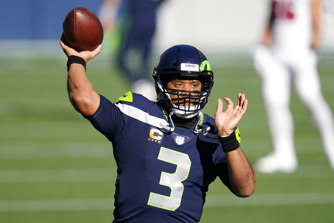 Seattle Seahawks quarterback Russell Wilson passes during warmups before the first half of an NFL football game against the San Francisco 49ers, Sunday, Nov. 1, 2020, in Seattle. (AP Photo/Elaine Thompson)