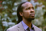"""FILE - In this Oct. 21, 2020, file photo, Ibram X. Kendi, director of Boston University's Center for Antiracist Research, stands for a portrait in Boston. Racism, COVID-19 and other big issues of the day figure prominently in the work of many of the 25 recipients of this year's John D. and Catherine T. MacArthur Foundation's """"genius grants,"""" announced Tuesday, Sept. 28, 2021. The group includes Ibram X. Kendi, the best selling author of """"How to be an Antiracist."""" (AP Photo/Steven Senne, File)"""