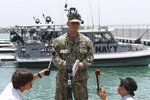 Cmdr. Sean Kido of the U.S. Navy's 5th Fleet talks to journalists at a 5th Fleet Base near Fujairah, United Arab Emirates, Wednesday, June 19, 2019. Cmdr. Kido said Wednesday that damage done last week to the Kokaku Courageous was