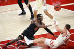 Wisconsin guard Brad Davison (34) fouls Maryland guard Darryl Morsell (11) during the first half of an NCAA college basketball game Wednesday, Jan. 27, 2021, in College Park, Md. (AP Photo/Nick Wass)