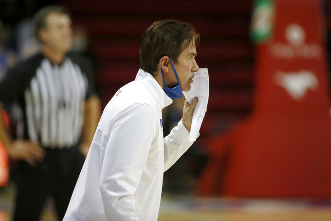 SMU head coach Tim Jankovich talks to his players from the sideline during the first half of an NCAA college basketball game in Dallas, Sunday, Jan. 3, 2021. (AP Photo/Roger Steinman)