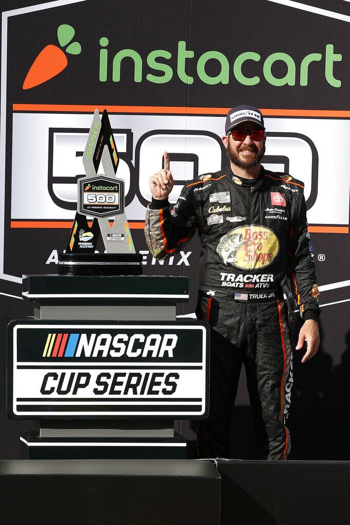 Martin Truex Jr. celebrates in Victory Lane after winning a NASCAR Cup Series auto race at Phoenix Raceway, Sunday, March 14, 2021, in Avondale, Ariz. (AP Photo/Ralph Freso)