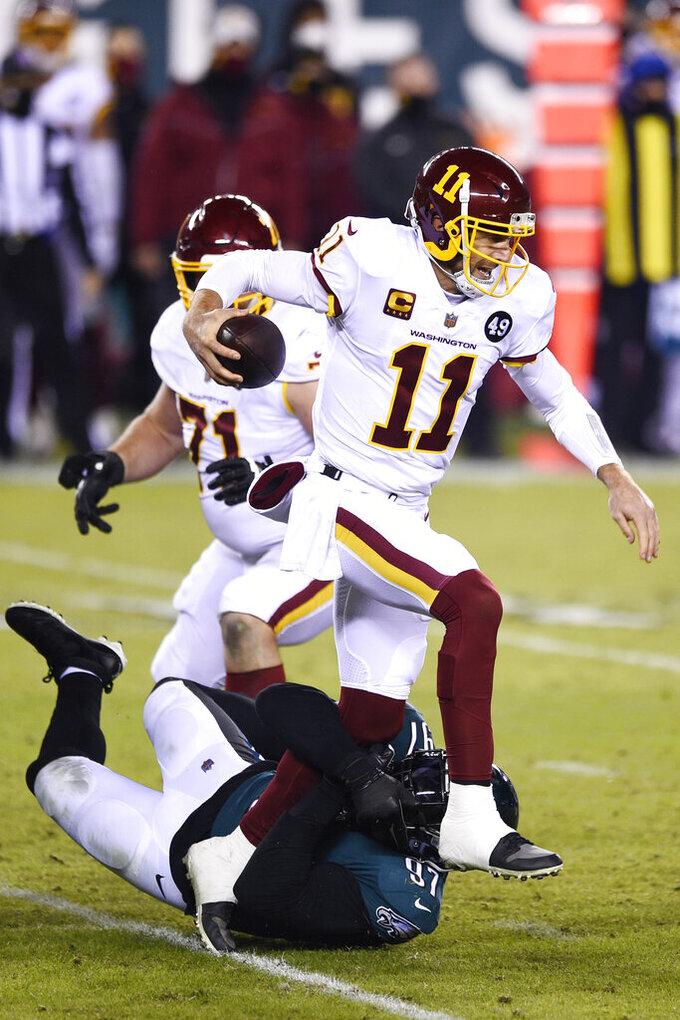 Washington Football Team's Alex Smith (11) is tackled by Philadelphia Eagles' Malik Jackson (97) during the second half of an NFL football game, Sunday, Jan. 3, 2021, in Philadelphia. (AP Photo/Derik Hamilton)