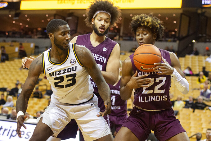 Southern Illinois' Harwin Francois, right, steals the ball from Missouri's Jeremiah Tilmon, left, as teammate Barret Benson, center, looks on during the second half of an NCAA college basketball game Sunday, Dec. 15, 2019, in Columbia, Mo. (AP Photo/L.G. Patterson)