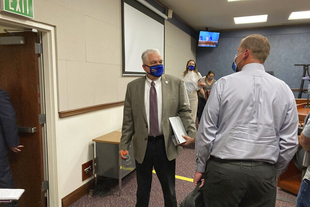 Nevada Gov. Steve Sisolak exits a press conference at the Nevada State Legislature in Carson City, Nev. on Wednesday, June 24, 2020. Sisolak announced Nevada would join California, Washington and North Carolina in requiring individuals wear masks in public places to contain the spread of coronavirus.(AP Photo/Samuel Metz)