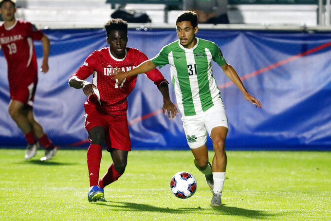 Marshall's Vitor Dias (31) controls the ball in front of Indiana's Herbert Endeley (17) during the first half of the NCAA College Cup championship soccer match in Cary, N.C., Monday, May 17, 2021. (AP Photo/Karl B DeBlaker)