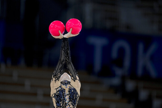 An Ukraine's rhythmic gymnastics' team member performs during the rhythmic gymnastics group all-around final at the 2020 Summer Olympics, Sunday, Aug. 8, 2021, in Tokyo, Japan. (AP Photo/Natacha Pisarenko)