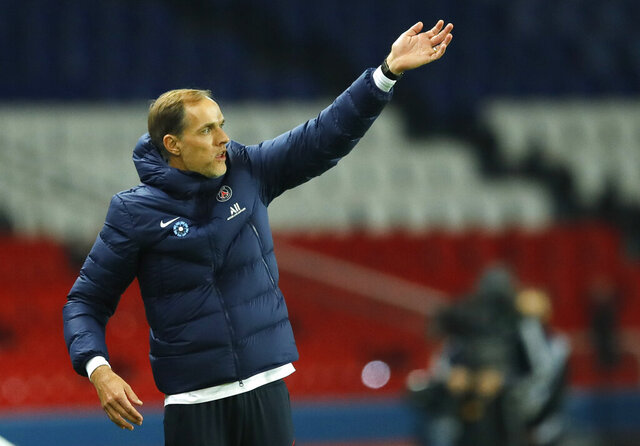 FILE - in this file photo dated Saturday, Nov. 7, 2020, PSG's head coach Thomas Tuchel gestures from the touchline during the French League One soccer match between Paris Saint-Germain and Rennes at the Parc des Princes in Paris, France.  Thomas Tuchel is confirmed as the new Chelsea soccer team manager, Tuesday Jan. 26, 2021. (AP Photo/Christophe Ena, FILE)