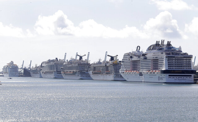 Cruise ships are docked at PortMiami, Tuesday, March 31, 2020, in Miami. (AP Photo/Wilfredo Lee)