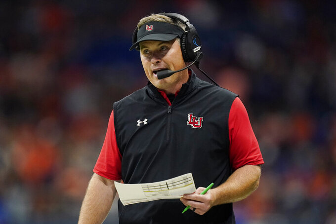 Lamar head coach Blane Morgan watches from the sideline during the second half of the team's NCAA college football game against UTSA, Saturday, Sept. 11, 2021, in San Antonio. (AP Photo/Eric Gay)
