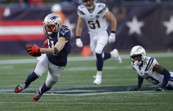 New England Patriots wide receiver Julian Edelman (11) runs after catching a pass against the Los Angeles Chargers during the second half of an NFL divisional playoff football game, Sunday, Jan. 13, 2019, in Foxborough, Mass. (AP Photo/Charles Krupa)