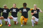 Players for the Utah Royals FC take a knee for the national anthem prior to their game against the Houston Dash during NWSL Challenge Cup at Zions Bank Stadium Tuesday, June 30, 2020, Herriman, Utah. (AP Photo/Rick Bowmer)