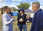 U.S. District Judge David Carter speaks with 41-year-old homeless resident Lori Werner during a tour of a homeless encampment along the Santa Ana River in Anaheim, Calif., Wednesday, Feb. 14, 2018. Carter demanded that Orange County officials provide answers about what federal funding is available to feed and temporarily house people if they are moved. (AP Photo/Amy Taxin)